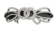 This medium size barrette decorated with tons of SWAROVSKI crystals measures about 3.5 inches wide and 1.25 inch high. The clasp on the back is about 2.25 inches long. P3