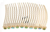 This gorgeous hair comb is decorated with SWAROVSKI CRYSTAL. The top measures about 4 inches wide 0.5 inches high. The teech is about 4 inches wide by 2.0 inches long.