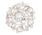This stunning crystal brooch rounded by seven big rhinestones measures 2 by 2 inches