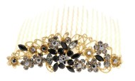 This gorgeous hair comb is decorated with SWAROVSKI CRYSTAL. The top measures about 3.5 inches wide 1.25 inches high. The teech is about 3.5 inches wide by 2.75 inches long. Y9
