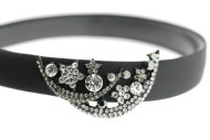 This black headband decorated with tons of Swarovski crystals measures approximately 0.75 in thick at center. The ornamentation is about 2.25 inches by 1.25 inches. G3