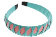 The comfortable headband is covered with colorful fabric and measures approximately 1.1 inches thick at center. One size. G1