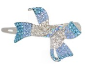 This small metal clamp is adorned with crystals. It measures approximately 3.1 inches long. H12