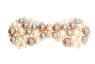 This gorgeous medium size barrette is decorated with rhinestones and pearl beads about 3.75 inches wide by 1.5 inches high. The clasp on the back is about 2.25 inches long. P2