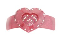 This medium size plastic barrette measures about 3.5 inches wide and 2.0 inches high. The clasp on the back is about 2.5 inches long. P22