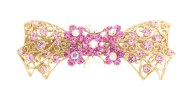 This barrette with lots crystal measures 3.1 inches by 1.25 inches. The clasp on the back is about 2 inches long. P14