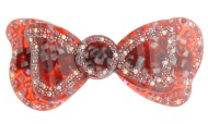 This plastic barrette is 3.75 inches wide and 1.75 inches high. The clasp on the back is about 2.5 inches long. P17