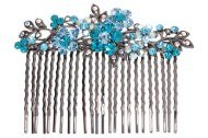 This gorgeous hair comb decorated with SWAROVSKI CRYSTAL measures about 3 inches wide 1.75 inches high. The top is about 3.5 inches by 1.25 inches. Y5